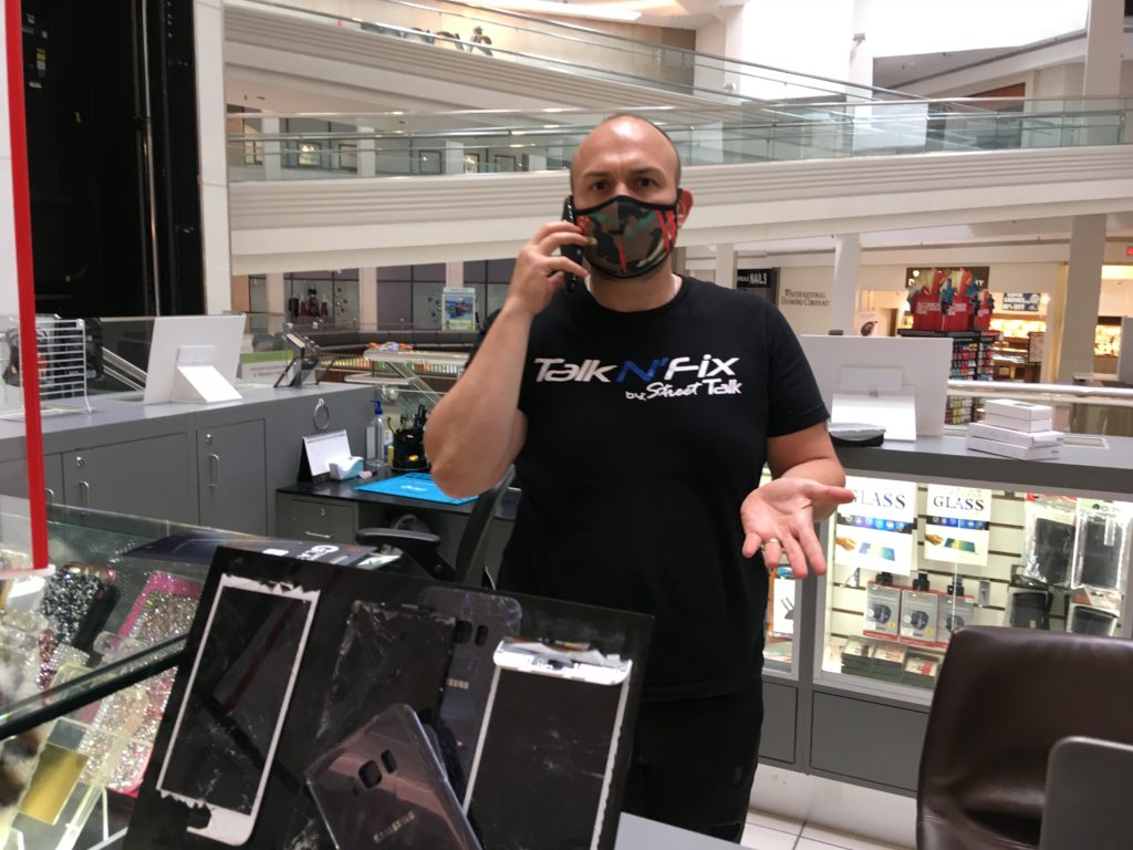Dennis Savchenko of Talk N'Fix at Woodfield Mall opened Friday May 29